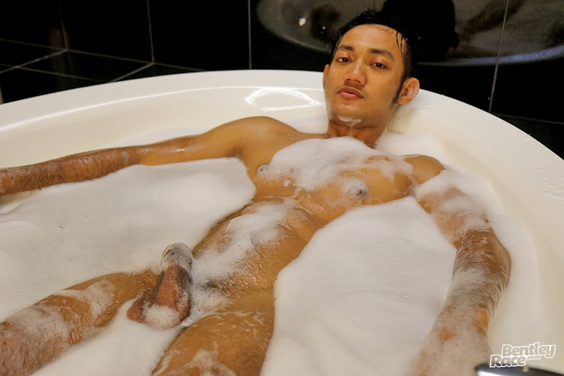 Sexy cute Indonesian guy Vino Rainz drops his speedos and jerks his huge dick