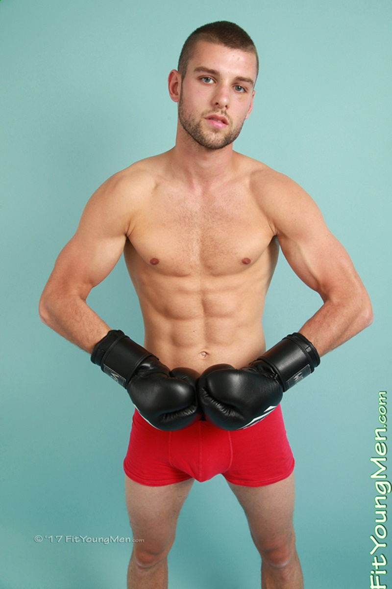 Straight young boxer Rufus Fitzroy strips out of his boxing kit showing off his big crotch bulge
